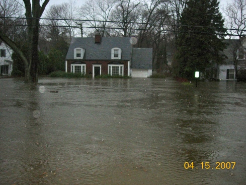 A few hours later ... House across the street is deluged with flood water.