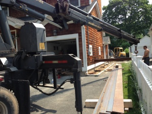 Snaking the steel beam through the house