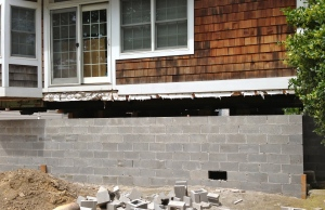 As the new foundation wall is completed, space is allocated for a flood vent.