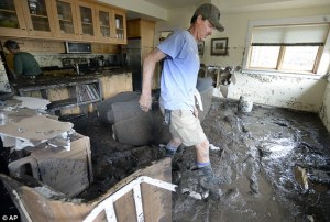 Photo credit: AP Mud encrusted homes in the aftermath of the Boulder flood - 2013